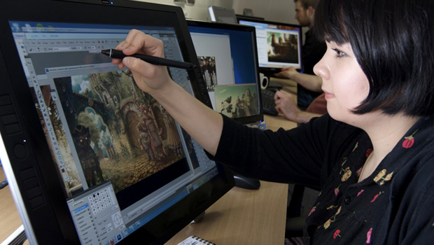 A Woman pointing something towards the screen.