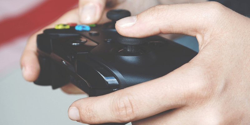 A Close-up view of a hand holding the gaming gear.
